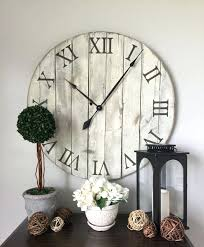giant wall clock handmade wooden clock assembled from pallet boards the color of paint used on the clock is hotel vanilla and the roman big wall clocks