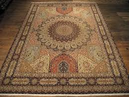 this persian rug features a large size and a gombad design this design type is specific for tabriz persian rugs and its characteristic appearance is a