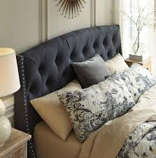 queen upholstered headboard in dark gray with tufting and nailhead