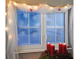 Infactory Fensterbild Schneeflocken Fensterdeko Glow In