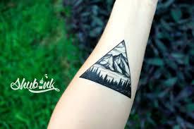 треугольник тату значение физическая и духовная силакрасота ума