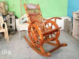 show only image red and brown wooden rocking chair