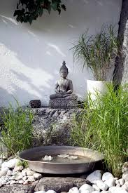 buddha statue in the garden of natural stone