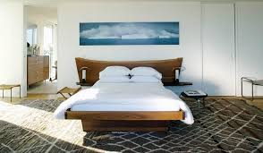 solid wood bedroom furniture and wall art above it on tranquil bedroom wall art with how to give character to a bedroom with a painting over the bed