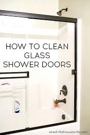 diy glass shower door cleaner i have two great tips for how to clean glass shower doors all need to get the doors sparkly clean are a pair of old hose