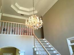 a foyer with two chandeliers hanging from the ceilng story foyer chandelier two ideas lighti on