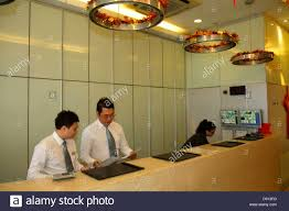 singapore jalan besar hotel 81 lobby front desk asian man woman job service inside interior budget hotel