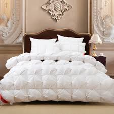 image of new white down comforter fluffy