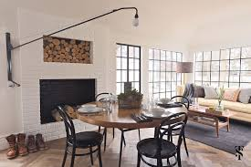 country club tudor dining table in front of fireplace with built in log holder