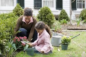 how to start an organic garden. Mother And Daughter Gardening How To Start An Organic Garden