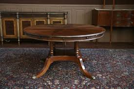 42 round pedestal dining table with leaf