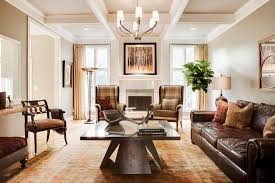 lovely transitional dries traditional living room in kansas city with leather sofa and oriental rug