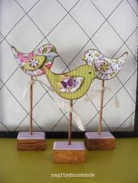 Our <b>wooden bird shapes</b>, covered with floral wrapping paper ...
