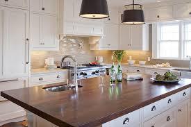 white kitchen island with dark wood countertop