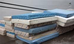 pile of mattresses.  Mattresses A Pile Of Mattresses Wait To Be Sent Through The Recycling Machine Inside Pile Of Mattresses S