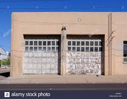 garage door artGarage door on an old Art Deco building Stock Photo Royalty Free
