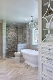 traditional bathroom lighting ideas white free standin. master bathroom with herringbone tile on floor freestanding tub and walk in shower traditional lighting ideas white free standin e