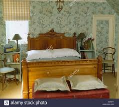 Chest for end of bed Foot Pale Green Wallpaper And Antique Wooden Bed In Country Bedroom With Silk Cushions On Chest At Wayfair Antique Chest End Bed In Stock Photos Antique Chest End Bed In