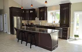 dark maple custom cabinets with quartz top and travertine splash
