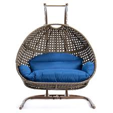 person hanging egg swing chair in blue