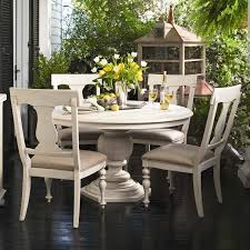 outdoor white round dining table