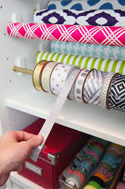 organized ribbon in gift wrap station a creative diy gift wrap station hand made stuff