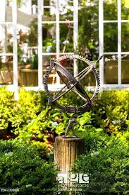 outdoor armillary sphere stock photo an on a pedestal in a garden setting with and an