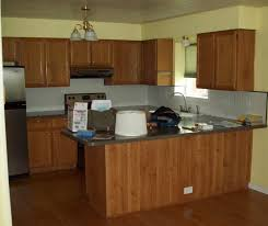 marvelous brown wooden kitchen cabinets with kitchen island also wooden floors as well as ceiling lights added neutral grey kitchen paint colors ideas