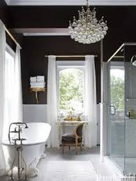 the master baths chocolaty walls play up the brilliant whites of a recycled tub curtains beautiful kitchen lighting