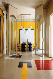 Yellow Office Casa Josephine Transforms Motorcycle Workshop Into Brightly