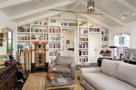 chic eclectic homeoffice built in book wall with iron pendant gray sofa paired book shelf wall