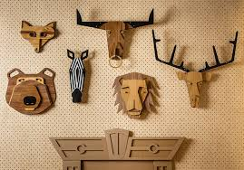 tzachi nevo has launched hunter wall a collection of wood taxidermy animal heads