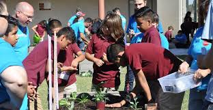 garfield elementary school sixth graders planting vegetables in the courtyard garden photo by lisa