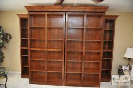 Bookcases hide a Murphy Bed. Bookcases swing open to reveal bed.