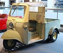 three wheeler an early daihatsu midget which would serve as the basis for auto rickshaws that proliferate across south and southeast asia