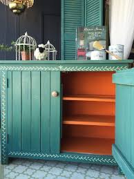 a pop of barcelona orange chalk paint on a painted cupboard by annie sloan stockist bench painted chalk paint