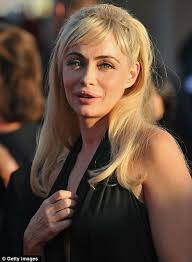 Botched: Emmanuelle Beart's tainted looks are clearly evident at the 36th Deauville Film Festival opening ceremony in France - article-0-121F291F000005DC-3_468x639