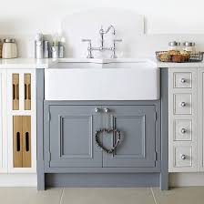 Image Pale Wood Cupboards In Modern Kitchen With White Wall Tiles Belfast Sink In Modern Kitchen