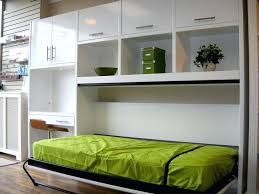 bedroom cool green murphy bed on white cabinet feats decoration racks and white desk with brown