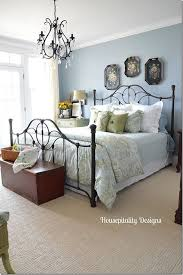 love the touches of black in this guest room iron bed chandelier u0026 tole painted trays above bed bed b25
