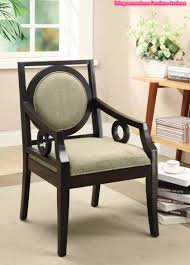 contemporary accent chair carvings on the exposed wood arms
