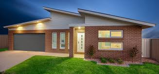 A beautiful facade with skillion roof, bricks and modern windows.