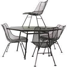 wrought iron and mesh table with chairs