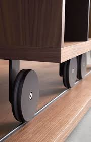 industrial furniture wheels. The Wheels On Bottoms Of This Sliding Bookcase Add An Industrial Touch To Modern Piece Furniture. Furniture
