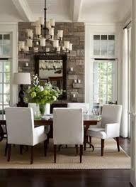 dark floor with neutral rug white chairs neutral chandelier stone on main wall bright dinningroom find this pin and more on beautiful dining rooms
