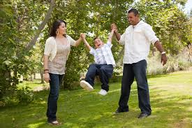 hispanic family activities. Hispanic Man, Woman And Child Having Fun In The Park. Family Activities E