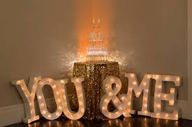 vintage marquee sign with gold glitter linens full