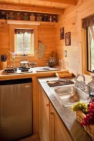 tiny house kitchens. fencl kitchen a tiny house design from the tumbleweed company -- i like this. more counter space. kitchens