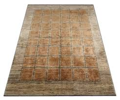 contemporary wool rugs has rich colors and abstract elements this modern carpet gives a subtle