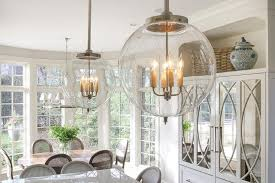 etched glass globe pendants over island